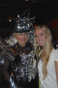 Amazing dress of flatware! Makeup by Hillary.