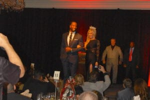 Larry Fitzgerald being auctioned off.